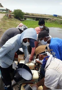 Youths preparing for the sanitisation exercise