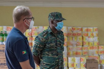 (Left to right) Tullow Oil Guyana's Country Manager Joachim Vogt and Director-General of the Civil Defence Commission (CDC) Lieutenant Colonel Kester Craig inspect the donated supplies