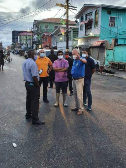 Mayor of Georgetown, Pandit Ubraj Narine and members of the Georgetown Mayor and City Council and the Georgetown Rotary Club in discussion before the sanitsation of the Bourda Market