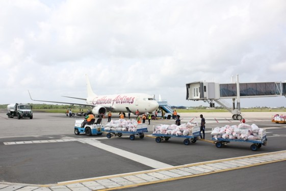 The care packagesfor Guyanese students in Cuba being loaded onto the Caribbean Airlines flight.
