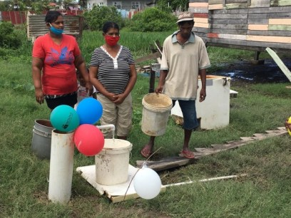 Residents awaiting turns to full their buckets