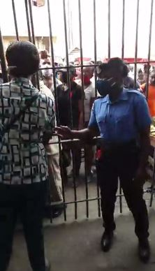 Members of the CityConstabulary and the authorities of the Stabroek Market, working to get thesituation under control