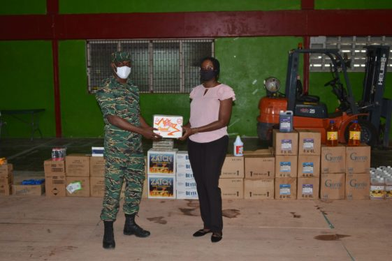 Director General of the CDC, Lt. Col. Kester Craig hands over the donated items to Coordinator of the Ministry of Public Health's Elderly Health Unit, Dr. Melissa Dehaarte