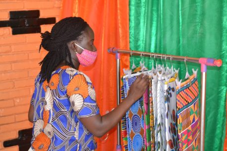 Entrepreneur Deborah Kehinde arranging a variety of African prints on the rack