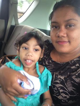 Davie Hussein with her three-year-old daughter Veena Kushera