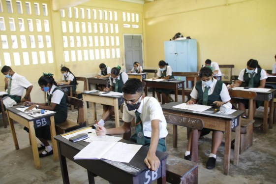 West Demerara secondary students seated in the exam room.