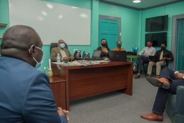 Minister within the Office of the Prime Minister, Hon. Kwame McCoy, meeting the senior staff members of the Department of Public Information (DPI)