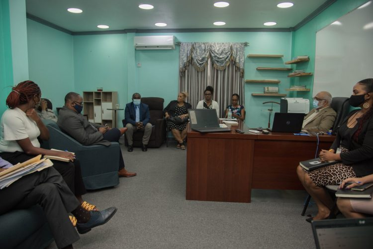 Minister within the Office of the Prime Minister, Hon. Kwame McCoy, meeting the senior staff members of the Department of Public Information (DPI). Also, in the photo is Mr. Neaz Subhan [second from right], who is currently overlooking content produced by the department