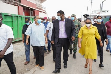President of the Cooperative Republic of Guyana, His Excellency Dr. Moahmed Irfaan Ali and First Lady Arya Ali engaging residents of Tiger Bay