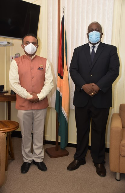 Prime Minister, Hon. (R'etd) Brigadier Mark Phillips and the High Commissioner of India to Guyana, H.E. Dr. K. J. Srinivasa