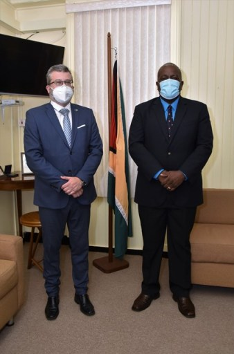 Prime Minister Brigadier Mark Phillips (right), and Ambassador of the Delegation of the European Union to Guyana, Mr. Fernando Ponz Canto, this morning, at the Office of the Prime Minister