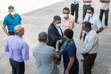 Guyana's Agriculture Minister, Hon. Zulfikar Mustapha greet staff at the GuySuCo head office