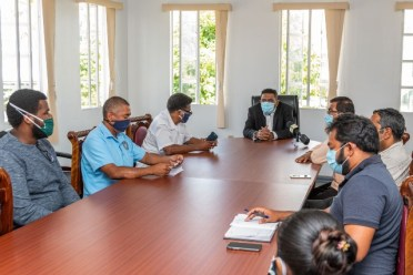 Guyana's Agriculture Minister, Hon. Zulfikar Mustapha interacts with member of staff at NDIA