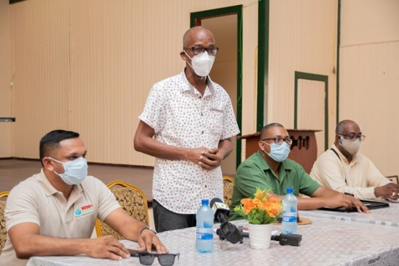 (from left) Minister of Natural Resources, Hon. Vickram Bharrat, Minister of Labour, Hon. Joseph Hamilton, Guyana Forestry Commissioner, Mr. Gavin Agard and Commissioner of the Guyana Geology and Mines Commission, Newell Dennison meeting with the residents and stakeholder in the logging industry in Kwakwani.