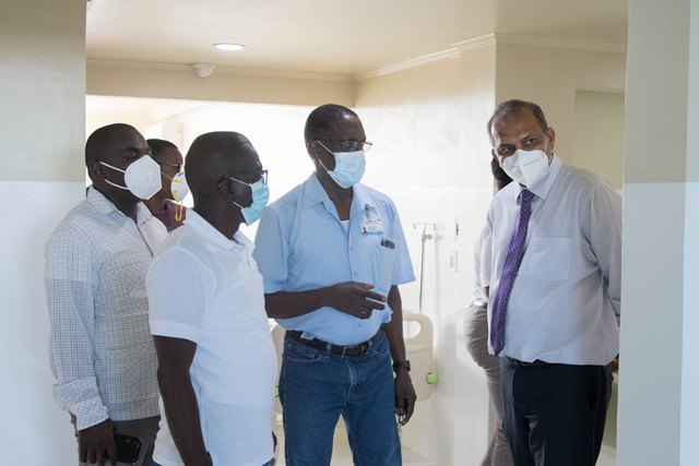 Minister of Health, Dr. Frank Anthony being given a guided tour of the COVID-19 hospital by Director of Medical and Professional Services, Dr. Fawcett Jeffrey and CEO of the GPHC, Brigadier Retired George Lewis. Also, in the photo is Minister of Public Affairs within the Office of the Prime Minister, Hon. Kwame Mc Koy along with other from the GPHC.