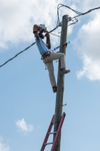 An electrical worker installing a street light