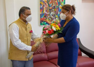 High Commissioner of India to Guyana, His Excellency Dr. K. J. Srinivasa present Minister of Education, the Honourable Priya Manickchand with a token of appreciation