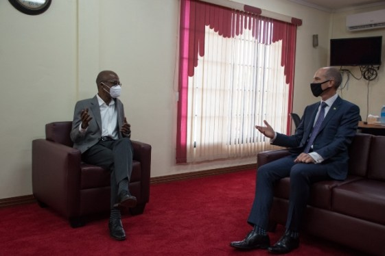 Minister of Labour, Hon. Joseph Hamilton in discussion with a representative of ExxonMobil