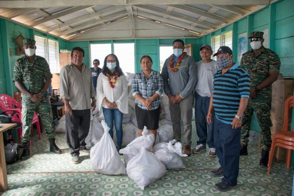 Minister of Amerindian Affairs, Hon. Pauline Sukhai, Minister of Local Government and Regional Development, Hon. Nigel Dharamlall, Director-General of the Civil Defense Commission (CDC), Lieutenant-Colonel, Kester Craig, and Major Loring Benons handing over the supplies to residents of Paramakatoi