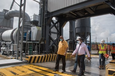 Plant Manager Troy Halley takes Minister Hon. Bishop, Juan Edghill and Minister Hon. Deodat Indar on a tour of the facility.