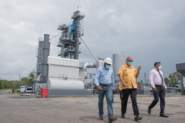 Plant Manager Troy Halley takes Minister Hon.Bishop, Juan Edghill and Minister Hon. Deodat Indar on a tour of the facility.