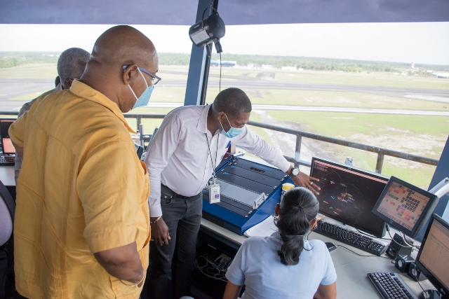 Public Works Minister, Hon. Bishop Juan Edghill inspect the control tower at CJIA.