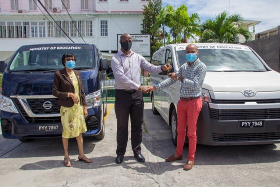 Permanent Secretary, Mr. Alfred King handing over keys to Coordinator of the Regional Special Education Needs/Disability Diagnostic and Treatment Centre, Mr. Keon Cheong