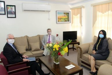 British High Commissioner to Guyana, His Excellency Greg Quinn, Minister of Human Services and Social Security, Hon. Dr. Vindhya Persaud, and Deputy High Commissioner, Ray Davidson in discussion