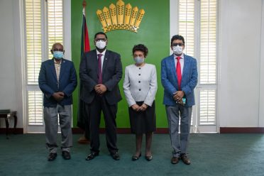 (From left) – Newly-appointed member of the PSC, Mr. Ganga Persaud, President of the Cooperative Republic of Guyana, His Excellency, President Dr. Mohamad Irfaan Ali, Chairwoman of the Guyana Elections Commission, Justice (R'etd) Claudette Singh and Minister of Legal Affairs and Attorney General, Hon. Anil Nandlall, at the swearing ceremony today