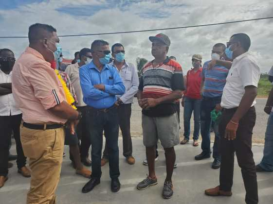 [In the photo, at extreme right] Minister of Agriculture, Hon. Zulfikar Mustapha, engaging farmers in Foulis, West Berbice.