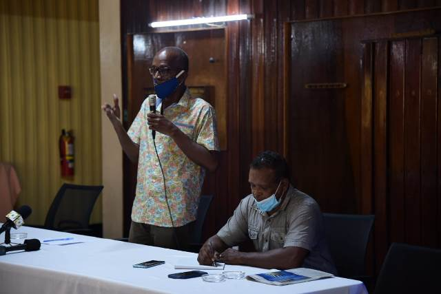 Minister or Labour, Hon. Joseph Hamilton addressing the gathering at Watooka Guest House, in Linden, Region 10. Seated is the Chairman of the proceeding Mr. Andrew Forsyth.