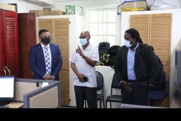 [From left] Minister of Natural Resources, Hon. Vickram Bharrat, Head of Compliance Derrick Lawrence, and Permanent Secretary, Joslyn McKenzie, during the Minister's tour of the annex.