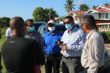 Minister of Housing and Water, the Hon. Collin Croal engaging with residents of West Berbice