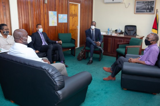[In the photo, at right] Minister of Labour, Hon. Joseph Hamilton, in discussion with CEO of GTT, Justin Nedd [left], along with Chief Labour Officer, Charles Ogle [second left], and the attorney representing the company.
