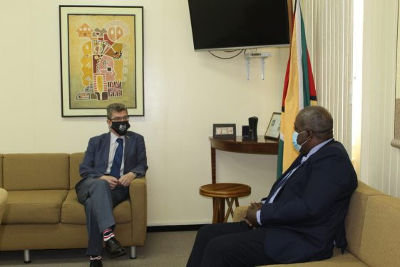 Prime Minister, Brig. (ret'd), Hon. Mark Phillips, and the British High Commissioner to Guyana, His Excellency, Greg Quinn, during the courtesy call today.