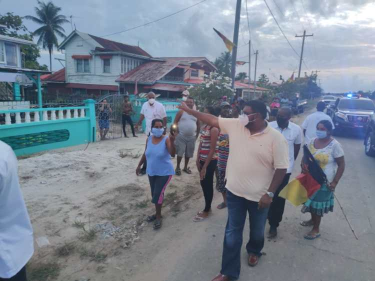 His Excellency, Dr, Mohamed Irfaan Ali, acknowledges a resident of Canal Number 1, West Bank Demerara as he conducts a walkabout the community accompanied by other persons from the area.