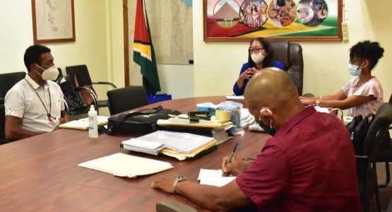 Minister of Amerindian Affairs, Hon. Pauline Sukhai, in discussion with the National Toshaos Council (NTC) Chairman, Mr. Nicholas Fredericks, and other Executive Members