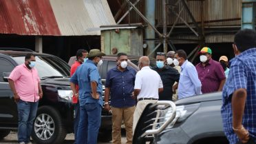 Minister Zulfikar Mustapha and other officials during a tour to the Skeldon Estate