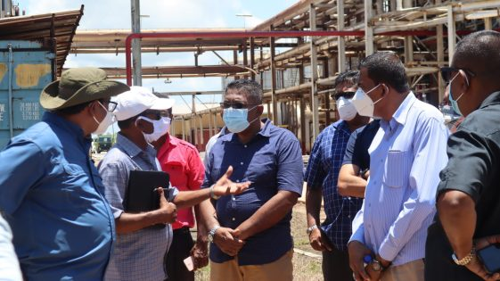 Minister Zulfikar Mustapha engaging officials during a visit to the Skeldon Estate
