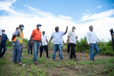 His Excellency, Dr. Mohamed Irfaan Ali and his team during a visit during to the proposed site for the construction of the new harbour bridge at Nandy Park, East Bank Demerara.