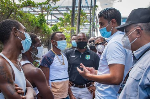 Minister of Culture, Youth and Sport, Hon. Charles Ramson Jr. engage with residents in Tiger Bay