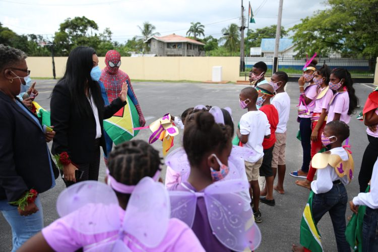 Minister of Human Services and Social Security, Hon. Dr. Vindhya Persaud interacting with the children of the Children and Family Center