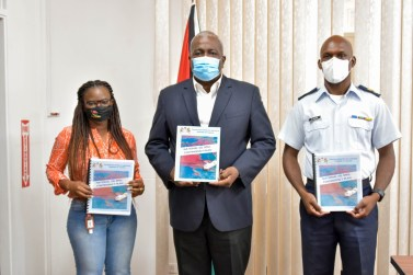 Prime Minister, Brigadier Mark Phillips (centre), Director General of the Civil Defence Commission (CDC), Lieutenant Colonel Kester Craig (right) and Project Manager, Civil Defence Commission, Ms. Anita Wilson, are pictured with copies of the National Oil Spill Contingency Plan in the boardroom of the Office of the Prime Minister, Colgrain House, Camp Street, Georgetown