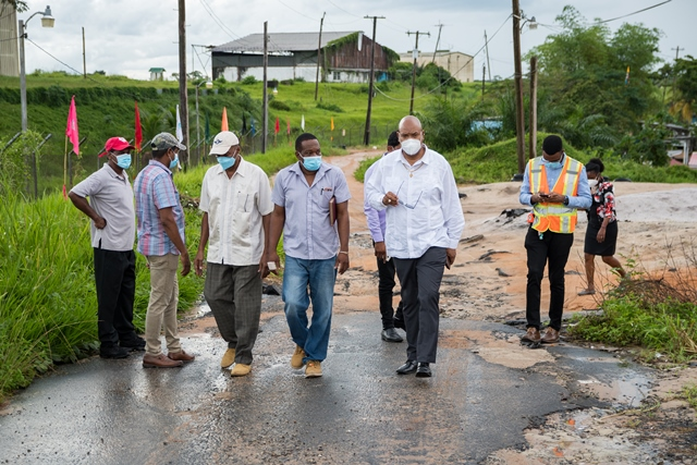 Minister of Public Works, Hon. Bishop Juan Edghill inspects G.A.C. Old Road at Timehri