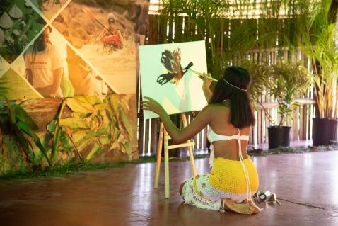A representative from Moraikobai paints the Canje Pheasant