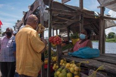 Minister of Public Works, Hon. Bishop Juan Edghill informing vendors of the regularisation that will be undertaken