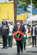 President Ali prepares to lay his wreath at the Cenotaph this morning.