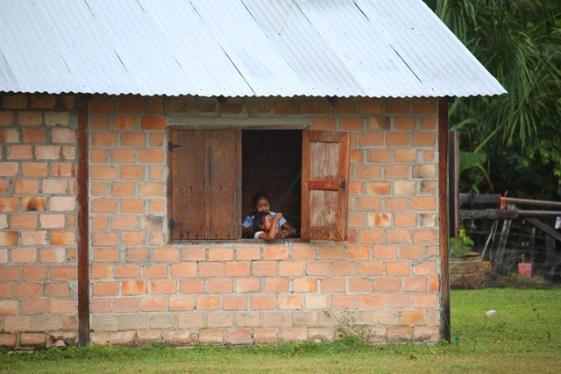 Two children playing at home in Karasabai
