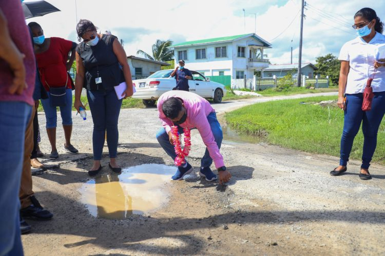 Minister within the Ministry of Public Works Hon. Deodat Indar inspects a broken street in Tuschen East Bank Essequibo