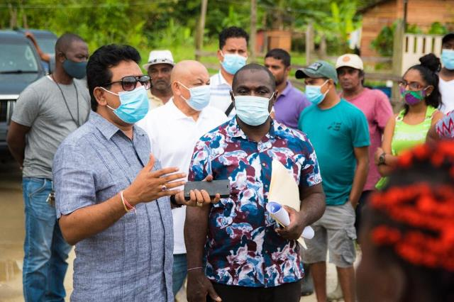 [from left] Attorney General and Minister of Legal Affairs, Hon. Mohabir Anil Nandlall and Minister of Public Affairs within the Office of the Prime Minister, Hon. Kwame McCoy, address some of the squatters' concerns.